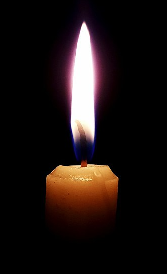 """<a href=""""https://commons.wikimedia.org/wiki/File:IMG_Candle_dark.jpg"""">Tmax1998</a>, <a href=""""https://creativecommons.org/licenses/by-sa/4.0"""">CC BY-SA 4.0</a>, via Wikimedia Commons"""